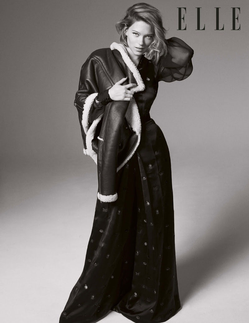 Lea Seydoux models leather jacket and long-sleeve gown