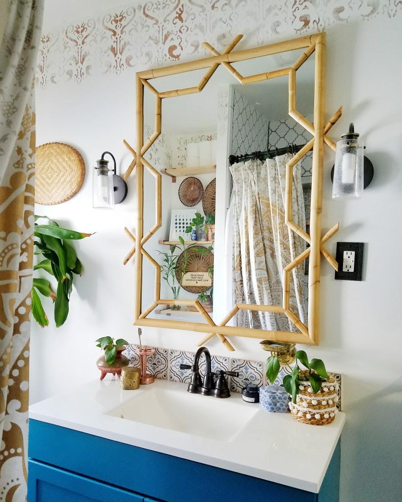 Global boho bathroom, rattan mirror, blue vanity