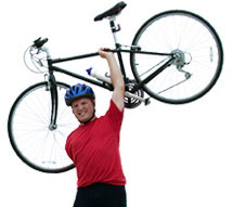 Man holding a bike above his head