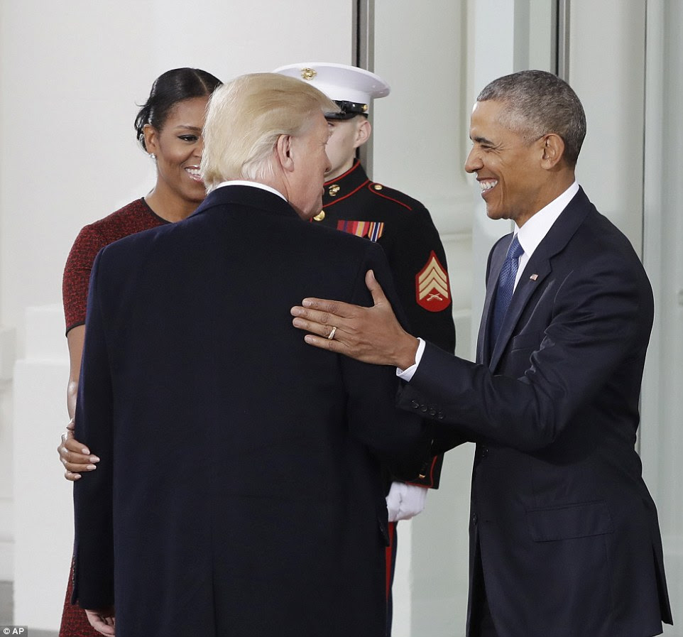 President Obama asked how Mr Trump was doing and shook his hand. Their wives then hugged