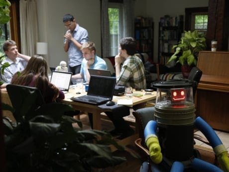 "HitchBOT at home with its research team in an undated photo taken in Port Credit, Ont. HitchBOT was brought to life to ""explore topics in human-robot-interaction and to test technologies in artificial intelligence and speech recognition and processing,"" the researchers said in a news release."