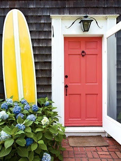 salmon door, hydrangeas, and a surf board