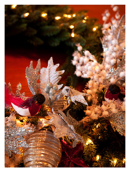 Pre-lit realistic wreaths from Balsam Hill are a snap to decorate for the season with glass ornaments, feathered birds, powdered beads, and glitter edged leaves.