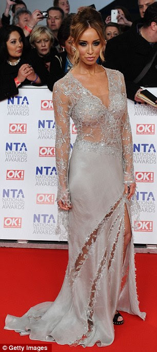 Sheer delight: Lauren Pope wowed in a sheer silver dress which showed a hint of skin