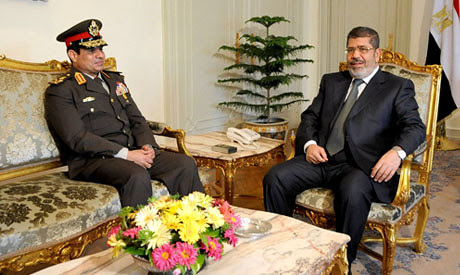 Egyptian Minister of Defense Lt. Gen. Abdel-Fattah el-Sissi with President Mohamed Morsi. There is a delicate relationship between the FJP and the military. by Pan-African News Wire File Photos