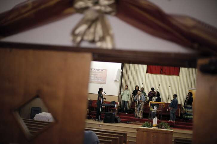 Elder Ron Rosson leads a song during choir rehearsal at the Pleasant Grove Baptist Church in Oakland, Calif., on Wednesday, October 28, 2015. The church has been feuding with the city of Oakland over an excessive noise complaint by an anonymous neighbor.