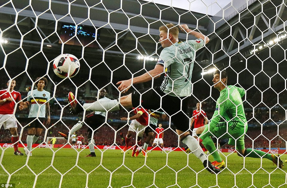 Kevin De Bruyne tries to clear the ball off the line, but having come off his post the Manchester City midfielder could not prevent the goal