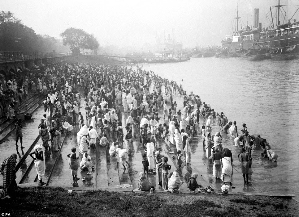 A crowded riverside with bathers at Chandpal Ghat in Calcutta, were among the photographs