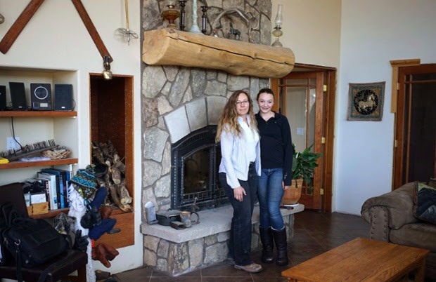 Denise Arthur, 52, and her daughter Linnaea Thibedeau, 13, stand together at home near Blackhawk, Colorado. Denise Arthur is a restoration ecologist. She has a PhD and finished her education at 34. Her ambition as a child was to be an animal behaviorist. Denise hopes her daughter Linnaea will become a biologist when she grows up. Linnaea would like to get a PhD and become a marine biologist.