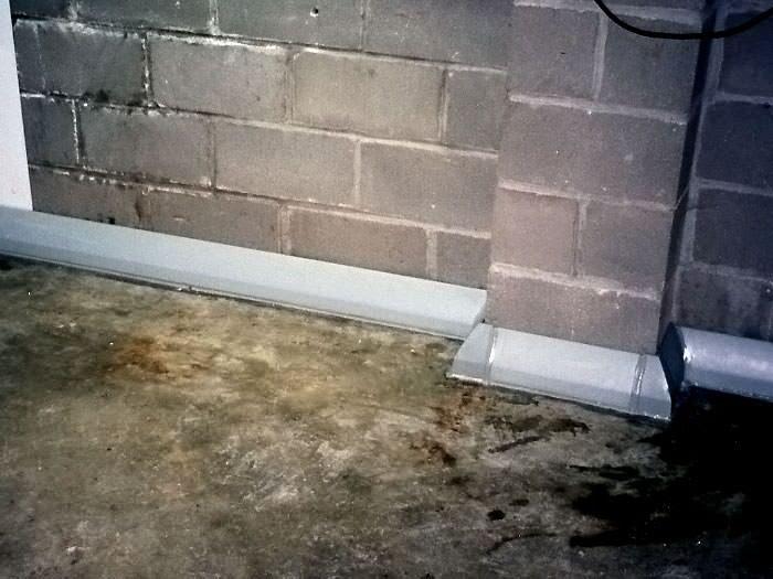 installed baseboard drain pipe lg