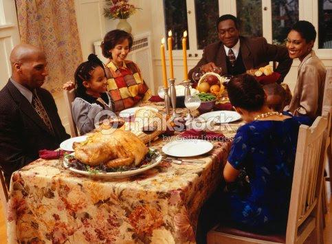 Family Eating Thanksgiving Dinner Stock Photo Thinkstock