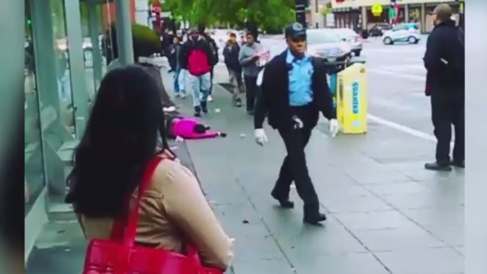 Image result for Howard University security guards appear to dump woman in a wheelchair onto sidewalk
