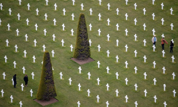 People walk among tombstones as they visit the World War II Normandy American Cemetery and Memorial at Colleville sur Mer near Omaha Beach, France. Preparations for the 70th anniversary of World War II D-Day are underway.