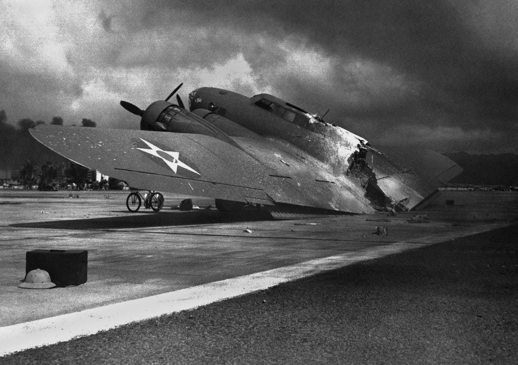 Ruins of a B-17C aircraft rests near Hickam Field after the attack. Nearly half of the approximately 60 airplanes at Hickam Field had been destroyed or severely damaged. (Photo: Newscom)