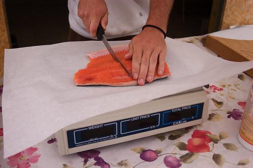 Thomas cuts the salmon