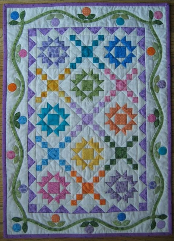Blossom Thyme Quilt - stars in pastel colours I LOVE pieced quilts with applique in the borders