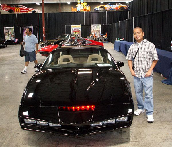 Posing in front of KITT from the classic TV show KNIGHT RIDER.