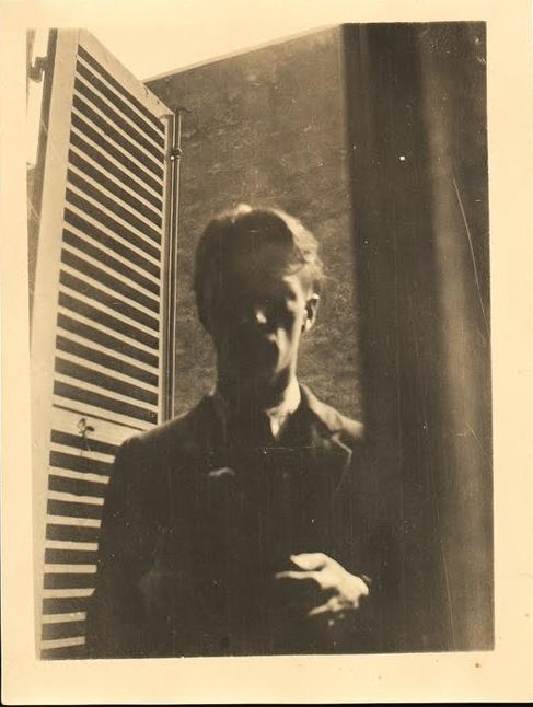 Self-portrait in Window, 5 rue de la Santé, Paris, 1923, by Walker Evans