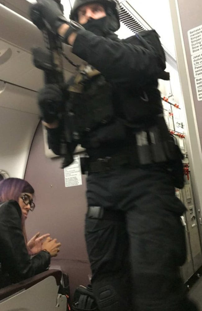 Police rush onboard. Picture: Andrew Leoncelli
