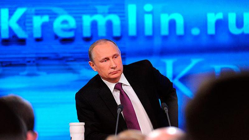 Vladimir Putin at a press conference on December 18, 2014. Kremlin press service, public domain.