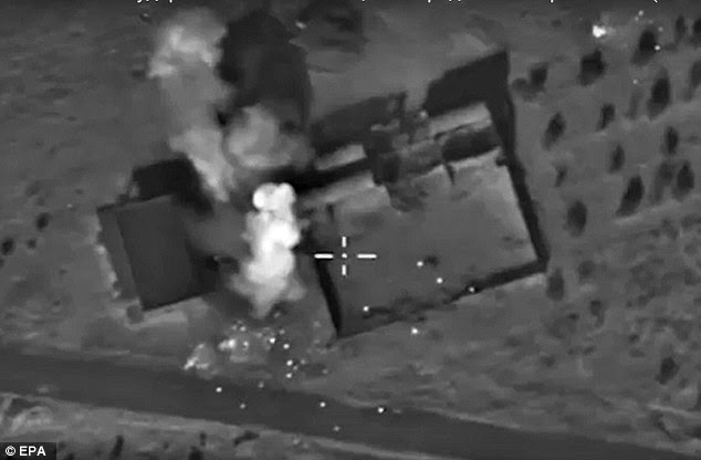 An aerial view of explosions at a fortified position in what Russia says was an ISIS ammunition depot in Syria. ISIS executioner Jihadi John is believed to have been killed in a similar strike by a U.S. drone
