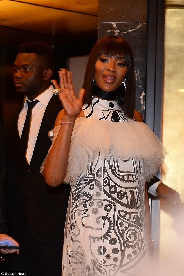 Extra detail: Naomi's ensemble also featured a lace outer layer, which was ruched at the top before cascading down to complete her glamorous look