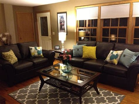 brown leather sofa  colorful pillows funky living room