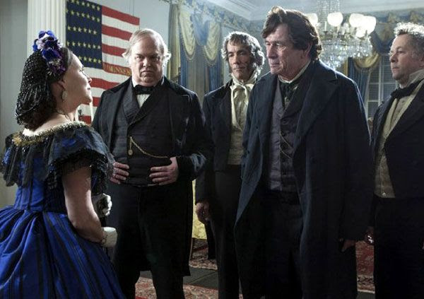Mary Todd Lincoln greets Republican leader Thaddeus Stevens (Tommy Lee Jones) during a White House dinner party in LINCOLN.