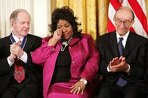 Queen of Soul Aretha Franklin wipes a tear aft...