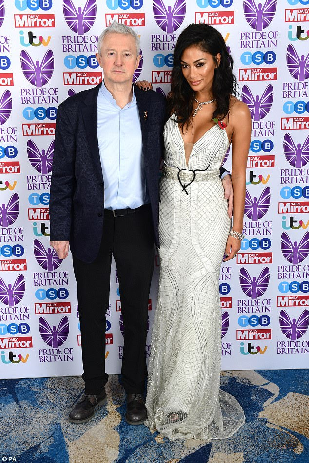 Co-stars: Nicole happily posed for cameras with fellow X Factor judge Louis Walsh