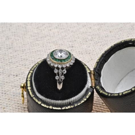 ANTIQUE DIAMOND AND EMERALD TARGET RING