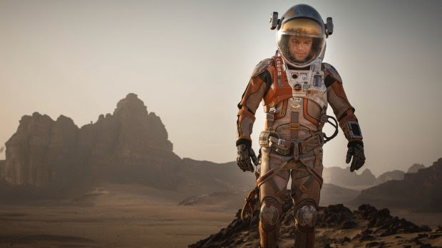 """This photo provided by courtesy of the Toronto International Film Festival and Twentieth Century Fox shows Matt Damon as Mark Watney a scene from the film, """"The Martian,"""" directed by Ridley Scott. As the largest launching pad to the fall movie season, the Toronto Film Festival which kicks off on Thursday, Sept. 10, 2015, is a regular home to the biopics and other true-life tales that usually populate awards season. """"The Martian,"""" starring Damon as an astronaut left for dead on Mars, gives Toronto its strongest dose of sci-fi spectacle.  (Aidan Monaghan/Toronto International Film Festival/Twentieth Century Fox via AP)"""