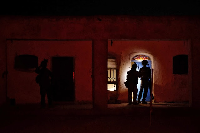 Members of the Afghan Special Forces search a house during a combat mission against Taliban, in Kandahar province. Image courtesy: Danish Siddiqui/Reuters