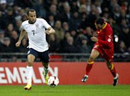 England's midfielder Andros Townsend runs with the ball during the World Cup 2014 qualifier between England and Montenegro at Wembley Stadium, London, on October 11, 2013