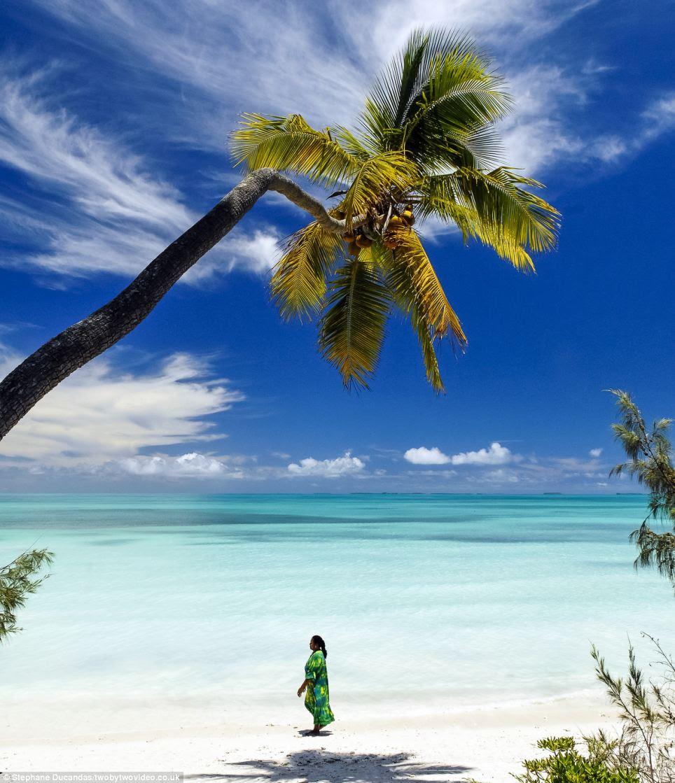 Seaside stroll: A local woman walks along the amazing coastline