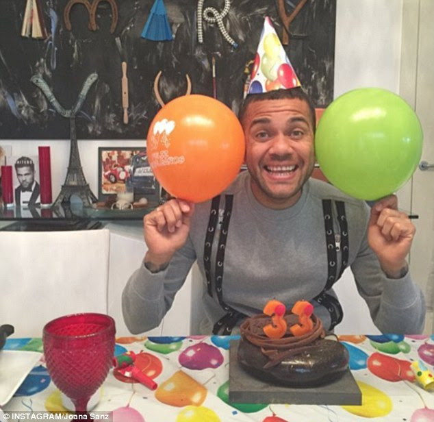 The 33-year-old celebrated with cake, balloons and a party hat with model girlfriend Joana Sanz