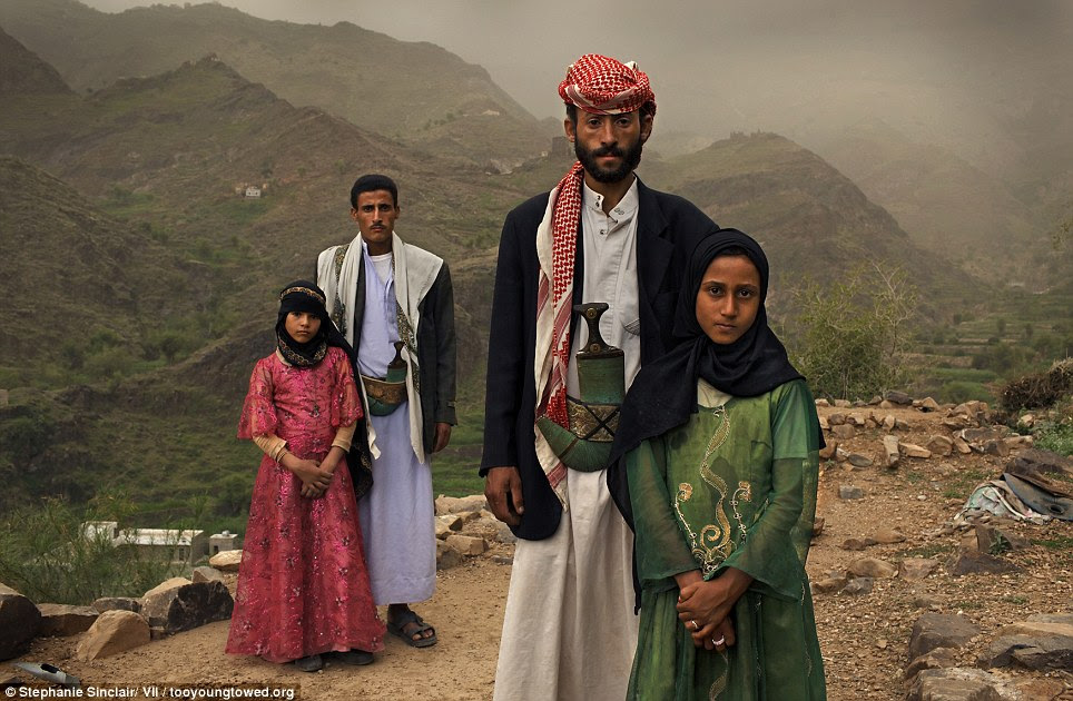 Minors: Tahani (front), 8, is seen with her husband Majed, 27, and her former classmate Ghada (rear), 8, and her husband outside their home in Hajjah, Yemen