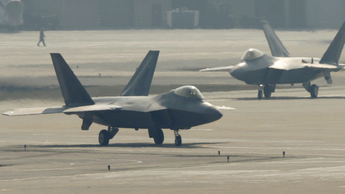 F-22 stealth fighter jets belonging to the U.S. Air Force move to take off at a U.S. air force base in Osan, south of Seoul April 3, 2013. (Reuters/Lee Jae-Won)