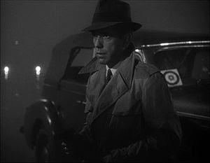 This screenshot shows Humphrey Bogart holding ...