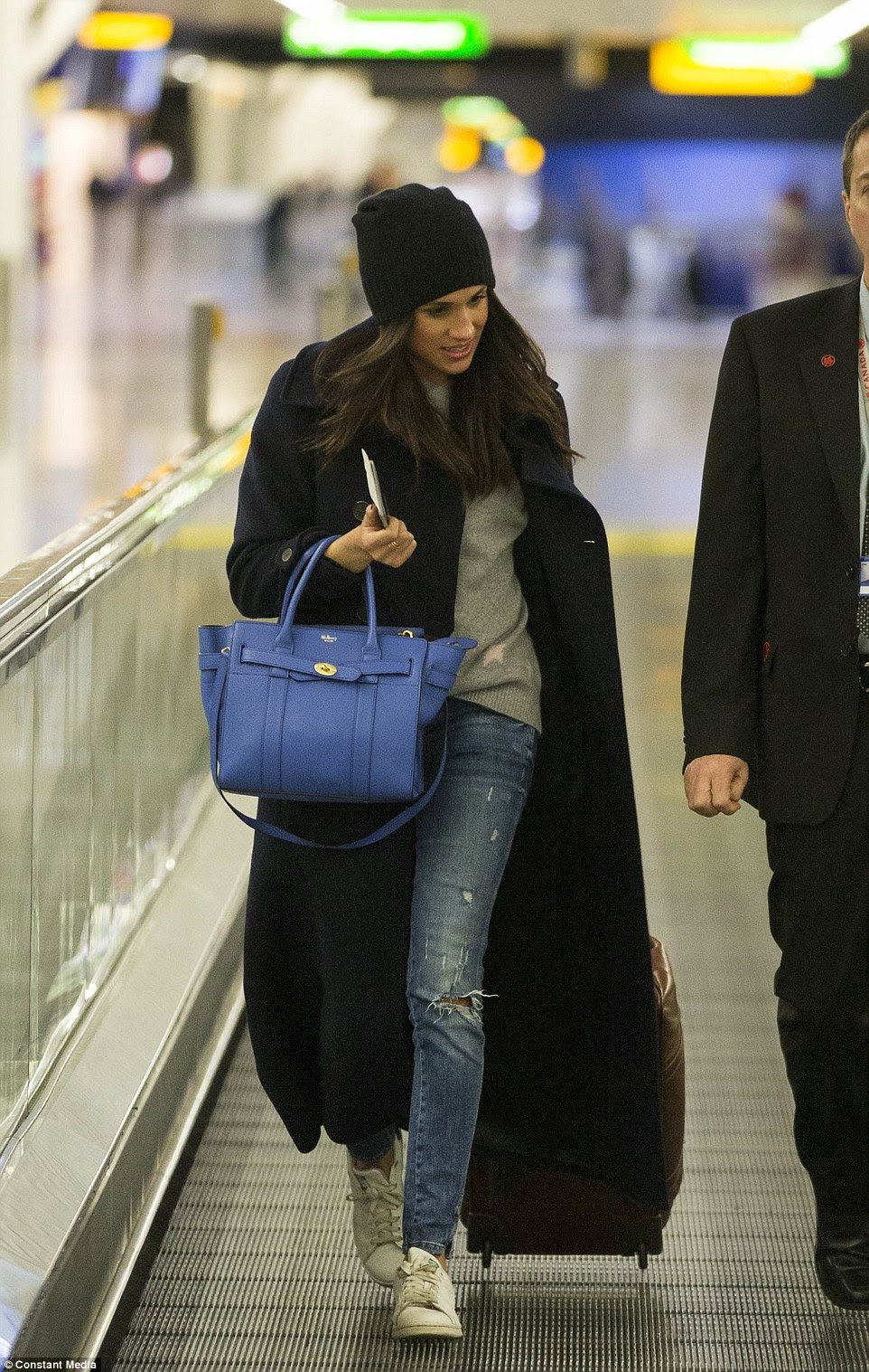 The Suits star was personally dropped off at the airport by Harry who was flanked by five protection officers