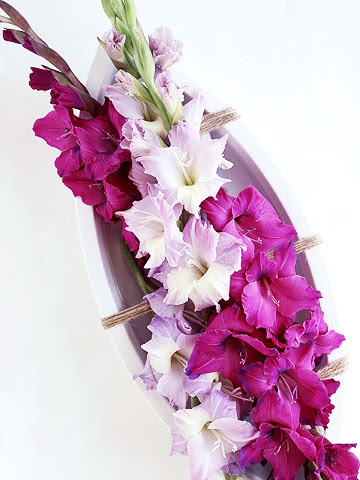 long dish full of pink gladiolas