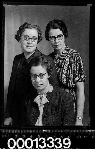 Group portrait of three women wearing glasses