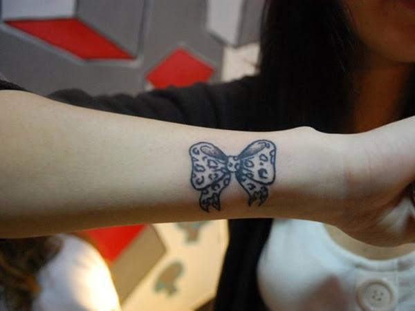 Side Wrist Leopard Bow Tattoo Idea