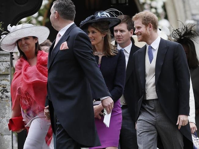 Prince Harry leaves the ceremony alongside fellow guests, with no sign of Meghan.