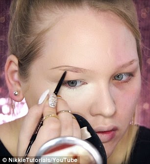 Master illisionist: Nikkie likes to create illusions with her eye make-up; she uses a brow pencil to make her brows look thicker (pictured) and eyeshadow to optically change the shape of her eyes