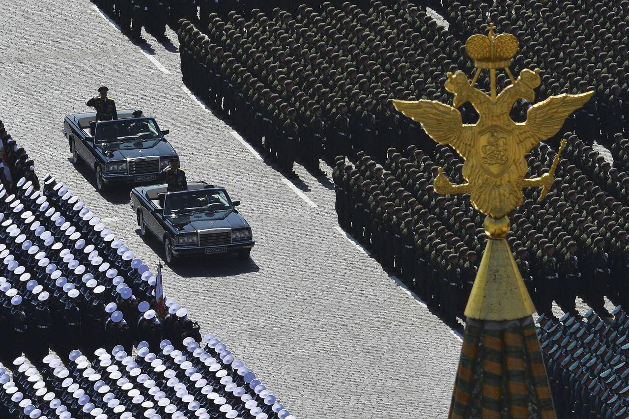 Russian Defense Minister Sergei Shoigu, standing in the leading car, and Colonel-General Oleg Salyukov, behind, review troops at the beginning of the parade.