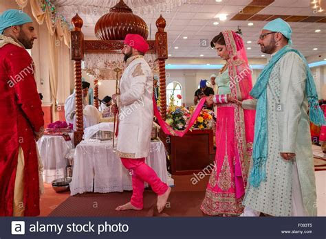 Sikh Bride and Groom Walking around the Holy Book at