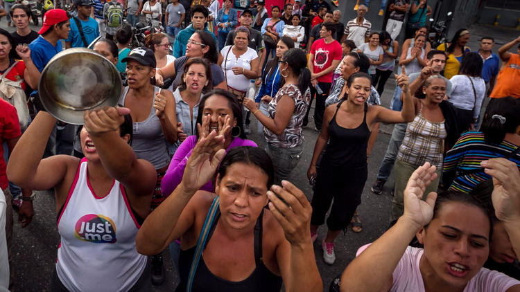 Demonstrators decry food shortages during a protest in the Catia district of Caracas, Venezuela.