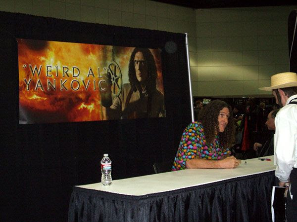 'Weird Al' Yankovic signs autographs at Stan Lee's Comikaze Expo in downtown Los Angeles, on November 2, 2013.
