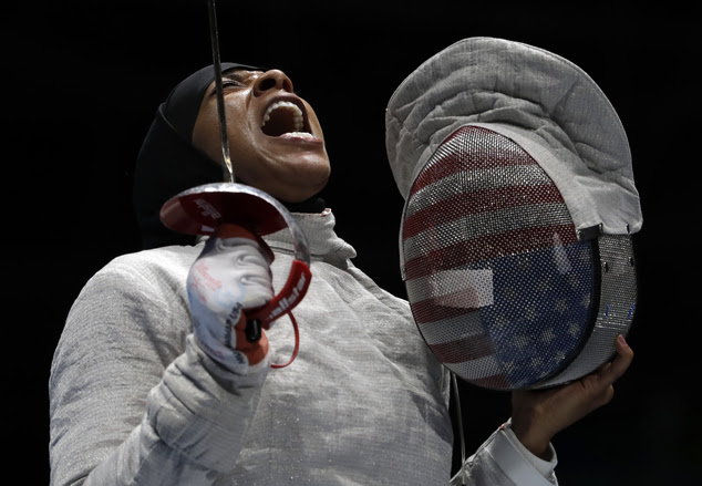 But the Muslim-American fencer said that she went to Rio for more than winning a medal, she went for all of the young American athletes she hopes to inspire. Muhammad celebrates after winning a point to Russia in a women's team sabre fencing semifinal
